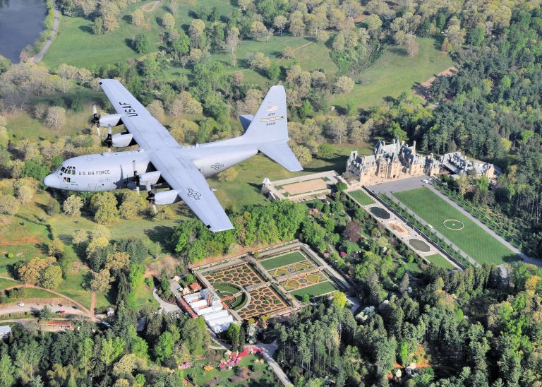 A C-130 H2 aircraft from the 440th Airlift Wing stationed on Pope AFB, North Carolina, flyes over the Biltmoore Mansion, which is the largest privately owned home in the United States.