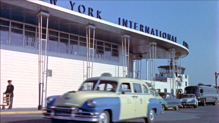387463740-idlewild-airport-air-terminal-taxi-vintage-car