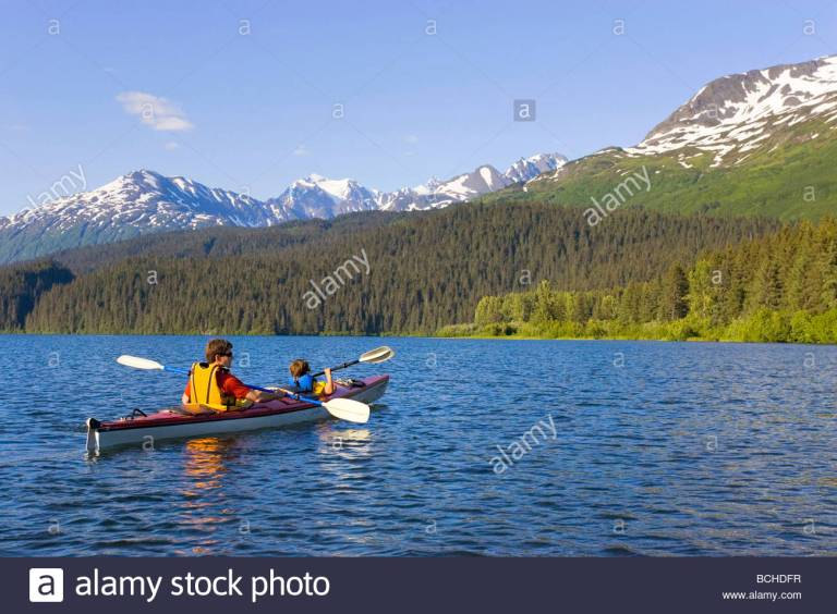 father-son-sea-kayaking-in-tandem-kayak-on-bear-lake-kenai-peninsula-BCHDFR